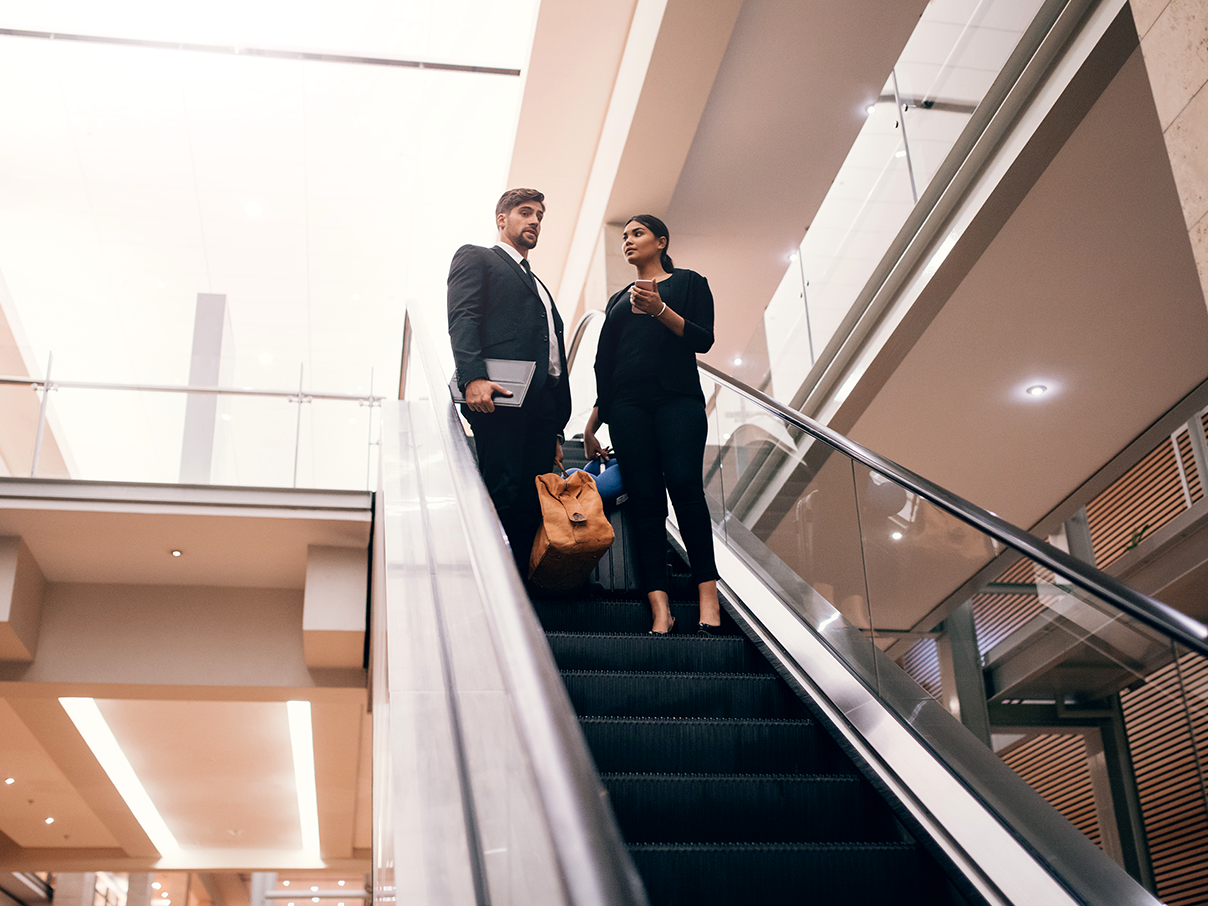 Business professionals on escalator _ Small Image