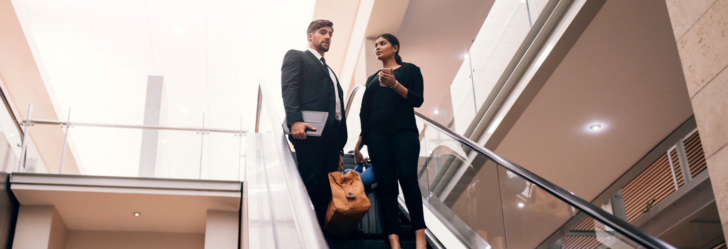 Business professionals on escalator